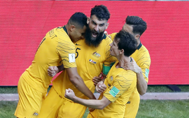 Australia's Mile Jedinak, center, celebrates with teammates after scoring his side's opening goal during the group C match between France and Australia at the 2018 soccer World Cup in the Kazan Arena in Kazan, Russia, Saturday, June 16, 2018. (AP Photo/Hassan Ammar)