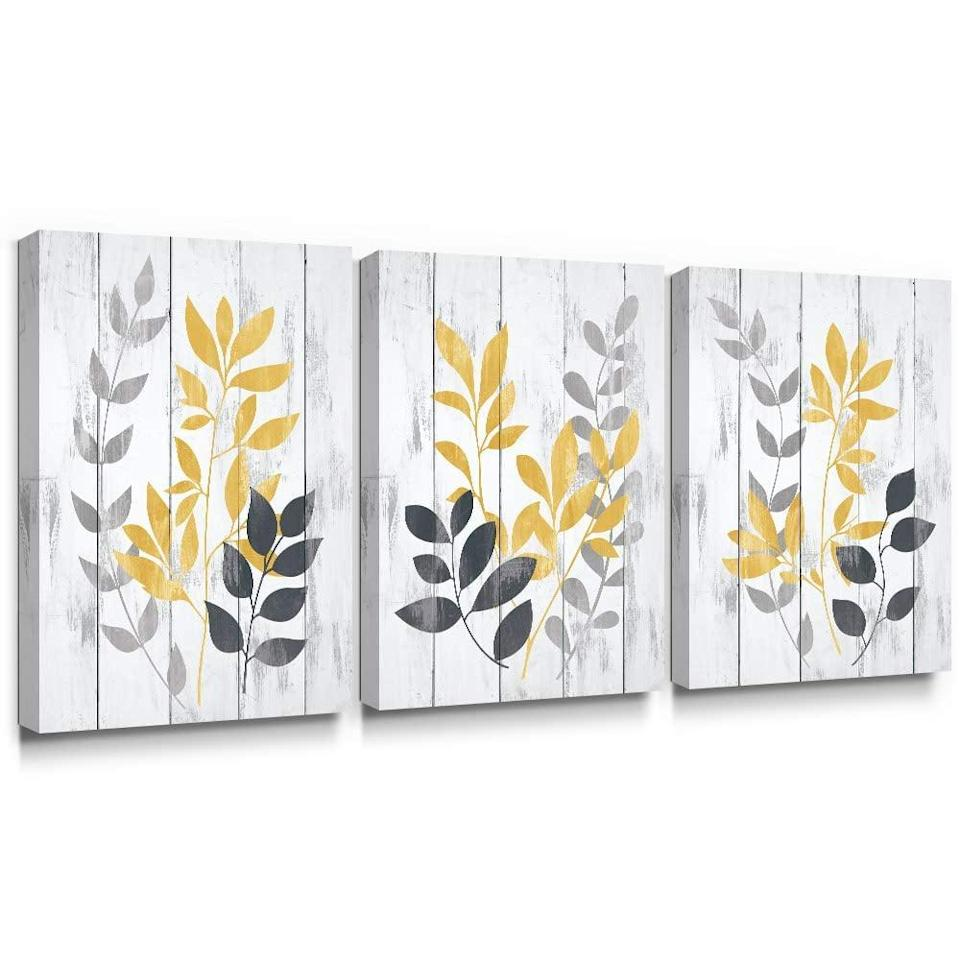 <p>The <span>Takfot Leaf Wall Art Yellow Grey Leaves Canvas Painting </span> ($43) is a great way to add a vintage, rustic farmhouse touch to your room!</p>