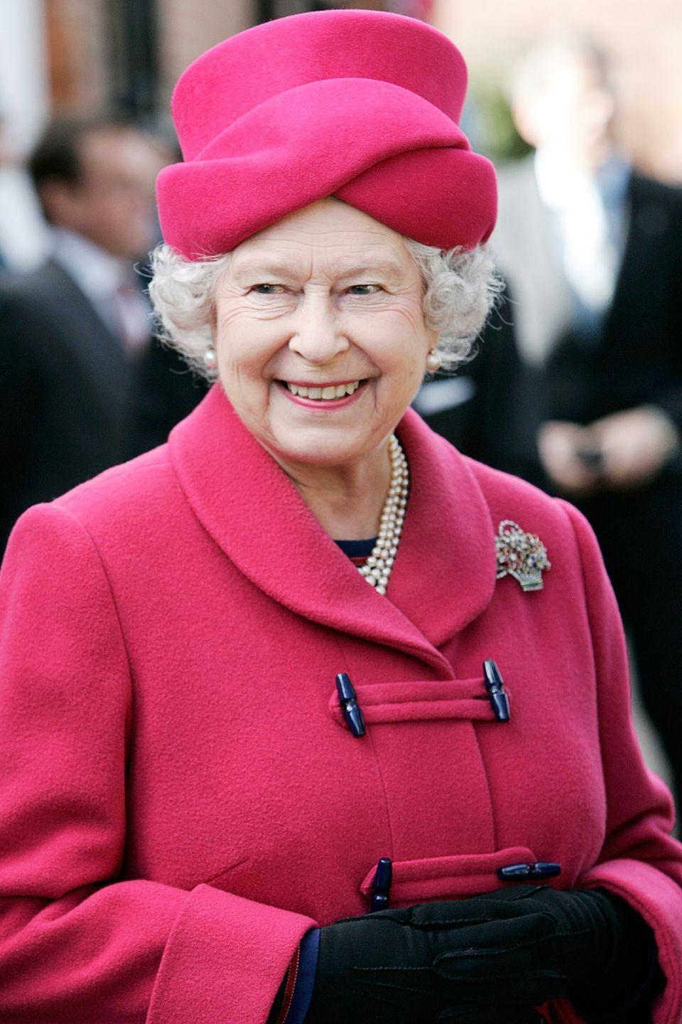 <p>The Queen glowed in the lush shade of cerise for a thanksgiving service at the Collegiate Church of St Mary in Staffordshire.</p>
