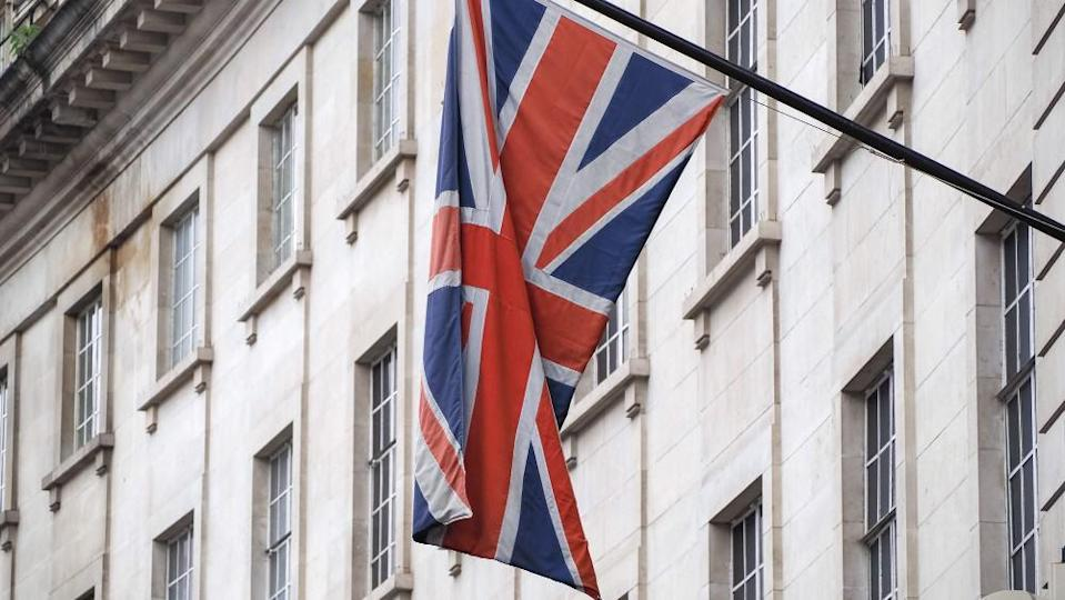 Union Jack flag hanging from a building