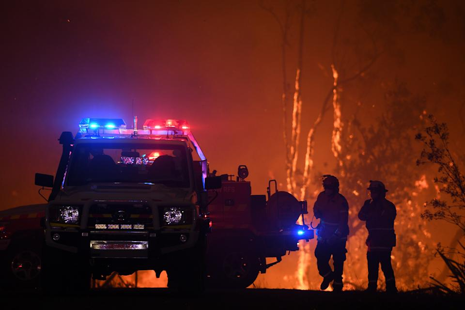 NSW Rural Fire Service crews protect properties on Waratah Road and Kelyknack Road near Mangrove Mountain. Source: AAP