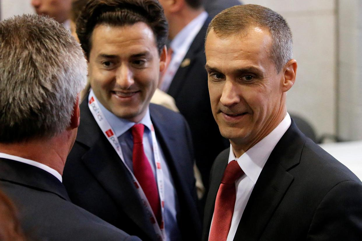 Corey Lewandowski, right, former Trump campaign manager, arrives in the spin room after the candidate's third and final debate against Hillary Clinton. (Photo: Jonathan Ernst/Reuters)