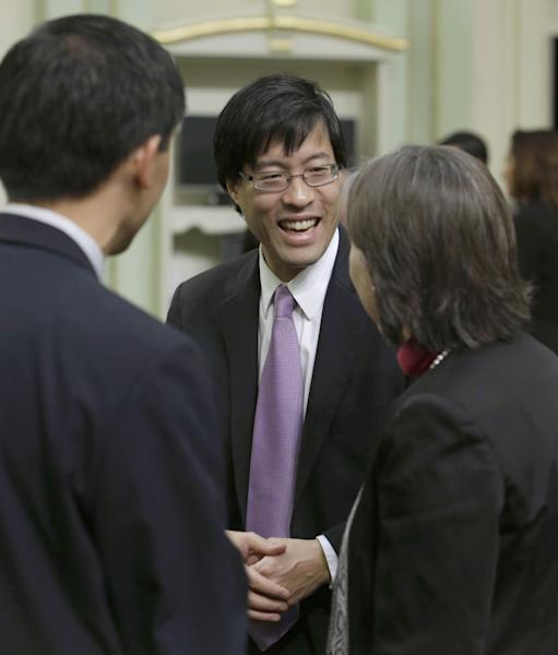 "California State Assemblyman Richard Pan, D-Sacramento, right, is seen after Gov. Jerry Brown, delivered his State of the State address at the Capitol in Sacramento, Calif., Thursday, Jan. 23, 2013. Millions of smokers could be priced out of health insurance because of tobacco penalties in President Barack Obama's health care law, say experts who are just now teasing out the potential impact of an overlooked provision in the massive legislation. ""We don't want to create barriers for people to get health care coverage,"" said California state Assemblyman Richard Pan, who is working on a law in his state that would limit insurers' ability to charge smokers more."" The federal law allows states to limit or change the smoking penalty. ""We want people who are smoking to get smoking cessation treatment,"" added Pan, a pediatrician who represents the Sacramento area. (AP Photo/Rich Pedroncelli)"