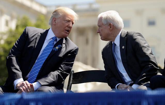 Trump speaks with Sessions at an event in May 2017. (Photo: Kevin Lamarque/Reuters)