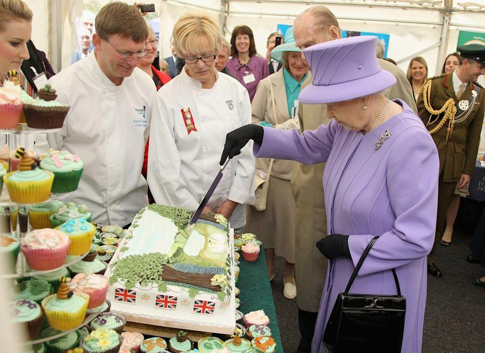 """<p>Though the protein may vary, the Queen sticks to the same meat-and-veggies format for the most part (with the meat very well done, always). She also requires <a href=""""https://www.cheatsheet.com/entertainment/queen-elizabeth-ii-eats-this-unhealthy-food-every-single-day.html/"""" rel=""""nofollow noopener"""" target=""""_blank"""" data-ylk=""""slk:chocolate biscuit cake"""" class=""""link rapid-noclick-resp"""">chocolate biscuit cake</a>. According to former royal chef Darren McGrady, """"she'll take a small slice every day until eventually there is only one tiny piece...she wants to finish the whole of that cake."""" He added that even when she travels, the cake goes with her.</p>"""