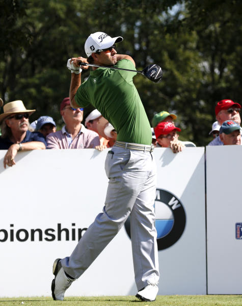 Adam Scott watches his tee shot on the 10th hole during the first round of the BMW Championship golf tournament at Conway Farms Golf Club in Lake Forest, Ill., Thursday, Sept. 12, 2013. (AP Photo/Charles Rex Arbogast)