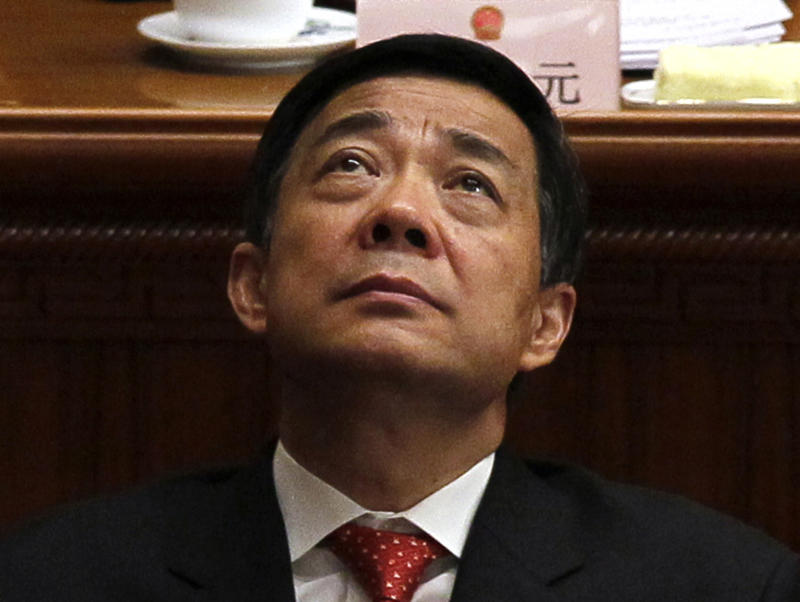 FILE - In this March 14, 2012 file photo, Bo Xilai, Chongqing party secretary, attends the closing session of the annual National People's Congress in the Great Hall of the People, in Beijing.  Chinese lawmakers stripped disgraced politician Bo Xilai of his last official position Friday, Oct. 26, 2012,  formally expelling him from the country's top legislature and setting the stage for criminal proceedings against the once-rising political star. (AP Photo/Ng Han Guan, File)