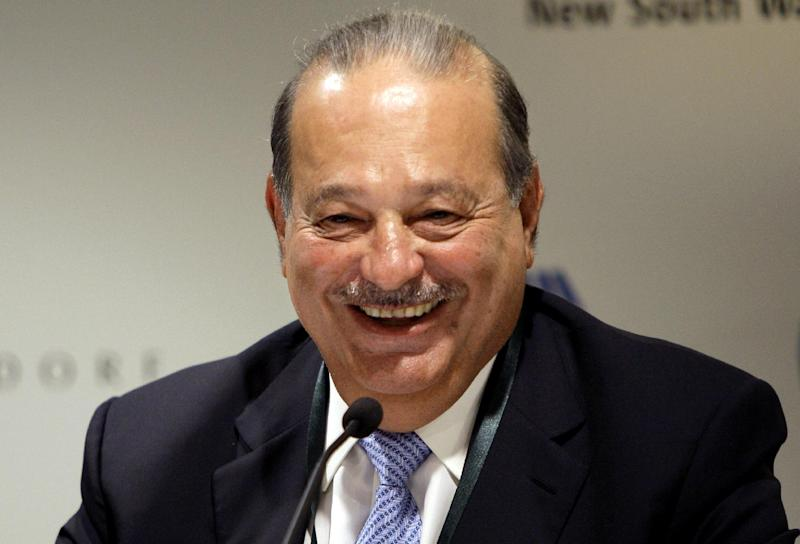 FILE - In this Wednesday, Sept. 29, 2010, file photo, Mexican tycoon Carlos Slim Helu holds a press conference at the Forbes Global CEO conference in Sydney. Forbes, on Monday, March 3, 2014, listed Helu as the world's second richest man. (AP Photo/Jeremy Piper)