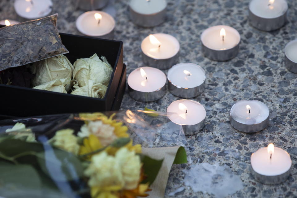 Candles are lit during a vigil in Toronto on Sunday May 30, 2021, for the 215 Indigenous children, whose remains were uncovered on the grounds of a former residential school near Kamloops, British Columbia. The discovery of a mass grave was announced late on Thursday by the Tk'emlups te Secwépemc people after the site was examined by a team using ground-penetrating radar. (Chris Young/The Canadian Press via AP)