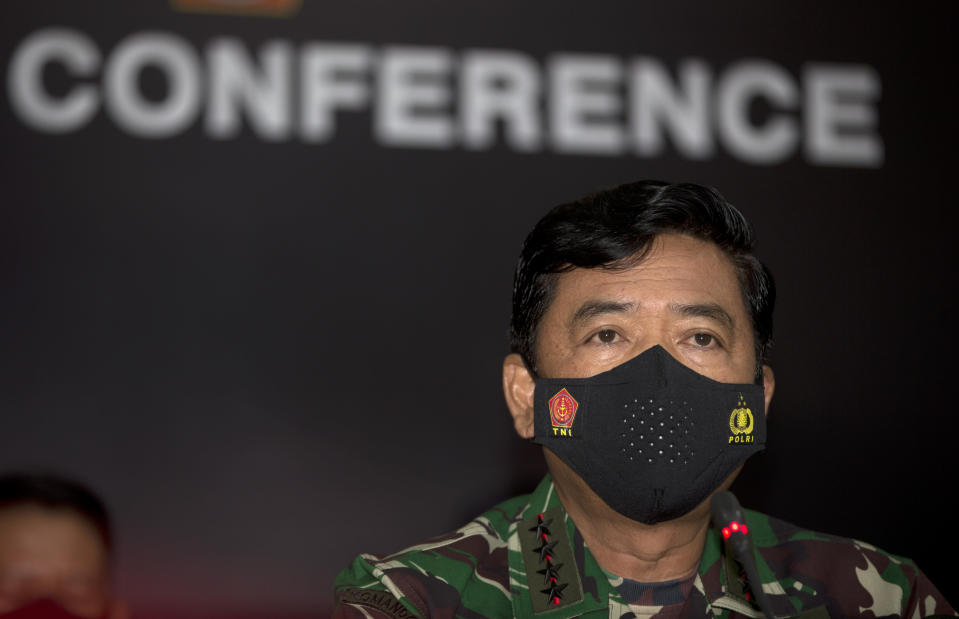 THIS CORRECTS THE NAME OF THE PHOTOGRAPHER TO LISNAWATI - Indonesian Military chief Hadi Tjahjanto talks during a news conference at Ngurah Rai Military Air Base in Bali, Indonesia on Sunday, April 25, 2021. Indonesia's military on Sunday officially admitted there was no hope of finding survivors from the submarine that sank and broke apart last week with 53 crew members aboard, and that search teams had located the vessel's wreckage on the ocean floor. (AP Photo/Firdia Lisnawati)