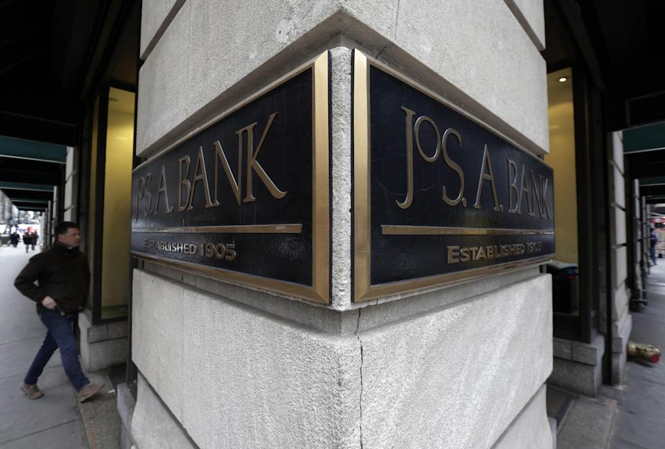 A man enters a Jos. A. Bank store, in New York. Men's Wearhouse is still trying to figure out the best strategy for its business since buying rival Jos. A. Bank, but needs to move quickly as its struggles continue. The men's clothing retailer reported Thursday, Dec. 10, 2015, that sales at Jos. A Bank locations open at least a year tumbled 14.6 percent in the third quarter as fewer customers visited those shops Mens Wearhouse Jos A Bank, New York, USA