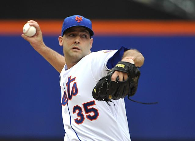 New York Mets starter Dillon Gee (35) pitches against the Philadelphia Phillies in the first inning of a baseball game on Sunday, Aug. 31 2014, in New York. (AP Photo/Kathy Kmonicek)