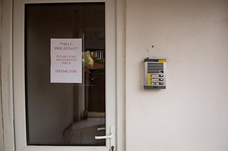 A stock photo of a self-isolation sign left outside a property, instructing where to leave deliveries, illustrating how self-isolating measures can be put in place. (Photo by Jacob King/PA Images via Getty Images)