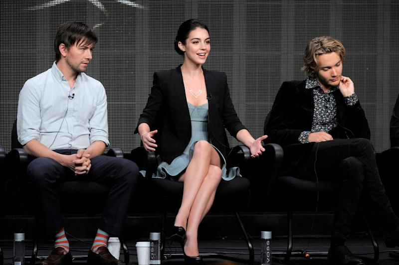 """Cast members, from left, Torrance Coombs, Adelaide Kane and Toby Regbo participate in the """"Reign"""" panel at the CW Summer TCA on Tuesday, July 30, 2013, at the Beverly Hilton hotel in Beverly Hills, Calif. (Photo by Chris Pizzello/Invision/AP)"""