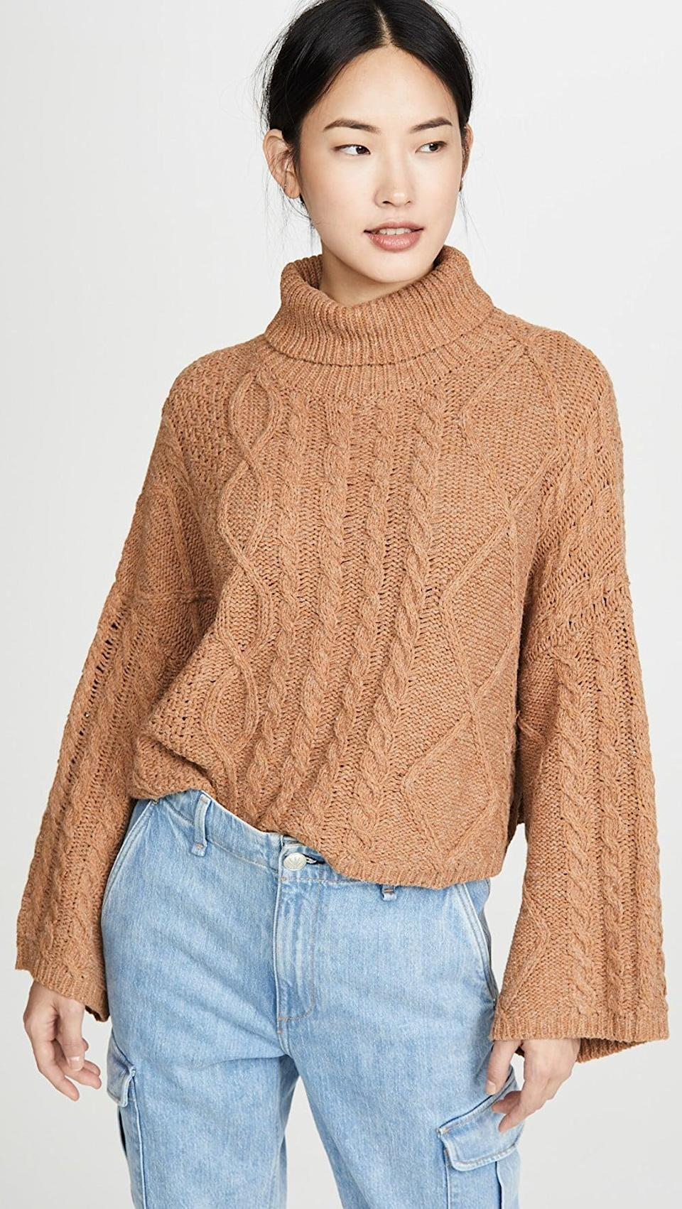 "<p>You can't go wrong with this <a href=""https://www.popsugar.com/buy/Line-amp-Dot-Kate-Cropped-Sweater-532941?p_name=Line%20%26amp%3B%20Dot%20Kate%20Cropped%20Sweater&retailer=shopbop.com&pid=532941&price=92&evar1=fab%3Aus&evar9=36291197&evar98=https%3A%2F%2Fwww.popsugar.com%2Ffashion%2Fphoto-gallery%2F36291197%2Fimage%2F47027888%2FLine-Dot-Kate-Cropped-Sweater&list1=shopping%2Choliday%2Cwinter%2Cgift%20guide%2Cwinter%20fashion%2Choliday%20fashion%2Cfashion%20gifts&prop13=api&pdata=1"" rel=""nofollow noopener"" class=""link rapid-noclick-resp"" target=""_blank"" data-ylk=""slk:Line & Dot Kate Cropped Sweater"">Line & Dot Kate Cropped Sweater</a> ($92).</p>"