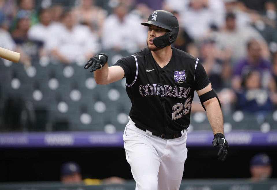 Colorado Rockies' C.J. Cron tosses his bat after hitting a grand slam off Milwaukee Brewers starting pitcher Brandon Woodruff during the first inning of a baseball game Thursday, June 17, 2021, in Denver. (AP Photo/David Zalubowski)