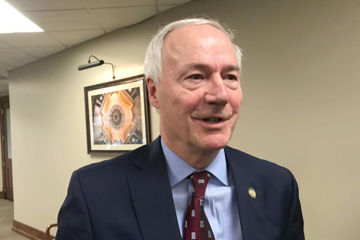 FILE - In this Jan. 13, 2020, file photo, Arkansas Gov. Asa Hutchinson speaks to reporters in Little Rock, Ark. On Tuesday, May 25, 2021, the American Civil Liberties Union asked a federal judge to strike down a new Arkansas law that made the state the first to ban gender confirming treatments or surgery for transgender youth. In April 2021, the Republican Legislature enacted the ban, overriding a veto by Hutchinson. (AP Photo/Andrew Demillo, File)