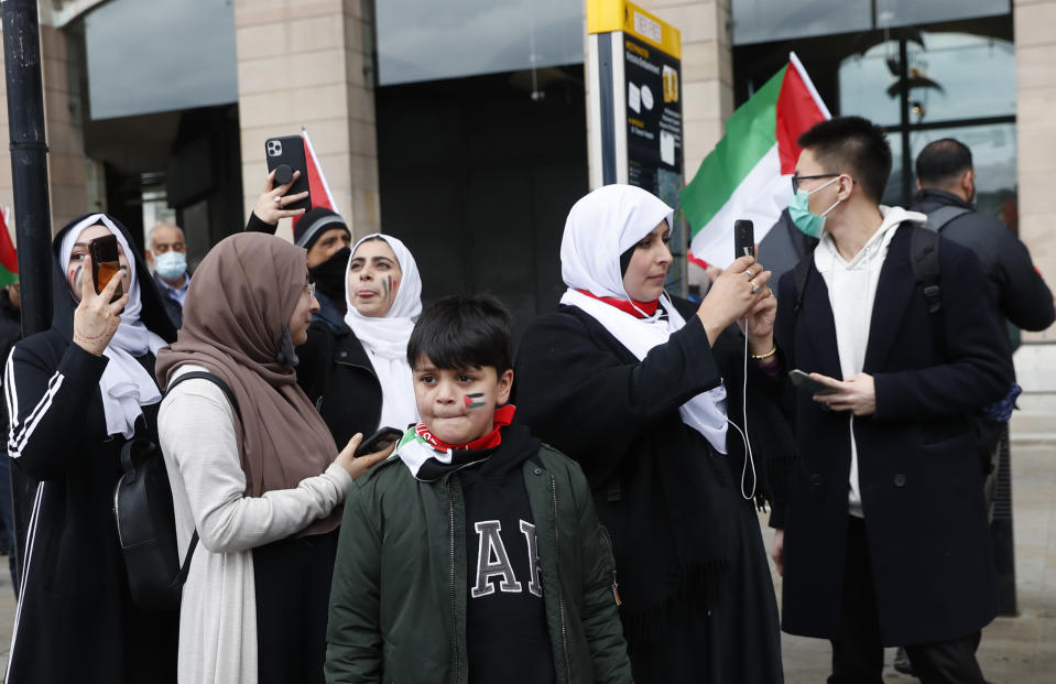 Protesters gather in London, Saturday, May 22, 2021, as they take part in a rally supporting Palestinians. Egyptian mediators held talks Saturday to firm up an Israel-Hamas cease-fire as Palestinians in the Hamas-ruled Gaza Strip began to assess the damage from 11 days of intense Israeli bombardment. (AP Photo/Alastair Grant)