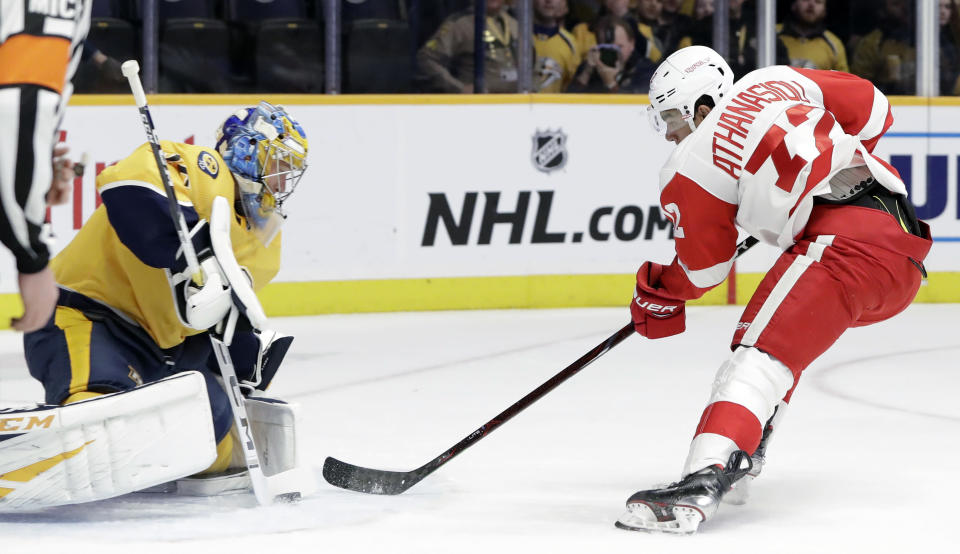 Detroit Red Wings center Andreas Athanasiou (72) shoots against Nashville Predators goaltender Pekka Rinne (35), of Finland, during the first period of an NHL hockey game Tuesday, Feb. 12, 2019, in Nashville, Tenn. (AP Photo/Mark Humphrey)