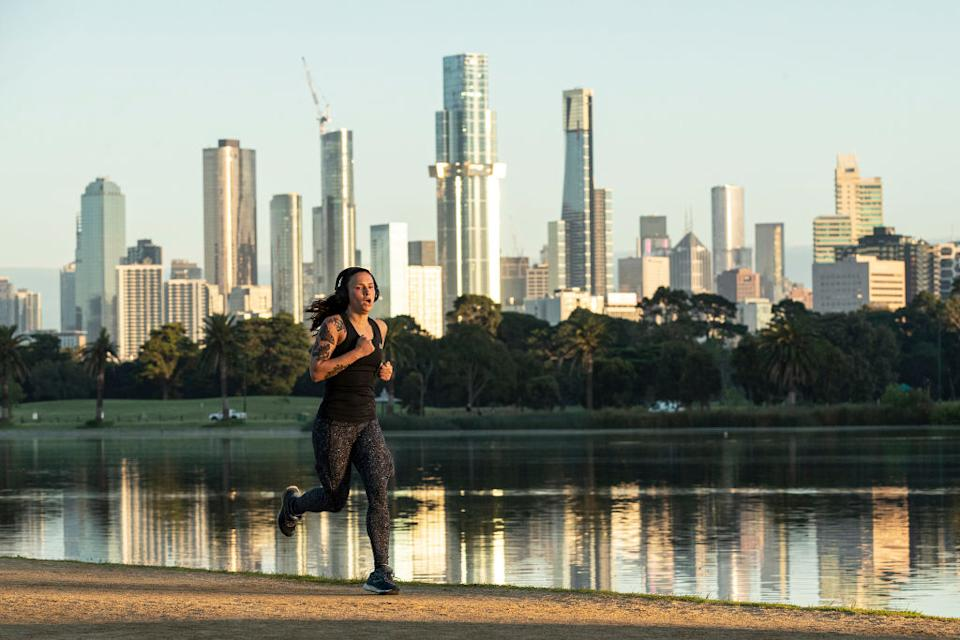 People exercise at Albert Park Lake in Melbourne, Australia.