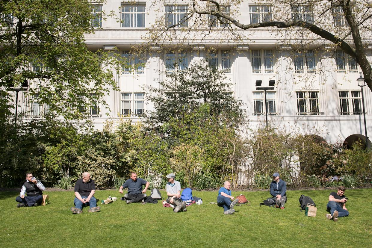 Workmen take their lunch break in Victoria Embankment Gardens in Westminster, central London as the spring weather continues. Picture date: Monday April 19, 2021.