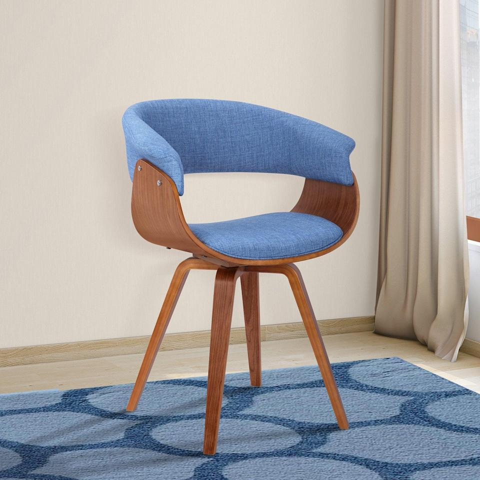 "<h2>Armen Living Summer Dining Chair</h2> <br><strong>Best For: Secret Desk Chair</strong><br>Wanna hear a secret? This ""dining chair"" is actually a rookie desk chair — built with a hidden swivel capability and sturdy bucket-seat design that is ready to support your WFH booty in MCM-style. <br><br><strong>The Hype: </strong>4.4 out of 5 stars and 383 reviews on <a href=""https://amzn.to/2z4Fd9y"" rel=""nofollow noopener"" target=""_blank"" data-ylk=""slk:Amazon"" class=""link rapid-noclick-resp"">Amazon</a><br><br><strong>Comfy Butts Say:</strong> ""This chair hit all the points for what I was looking for in setting up my office in this quarantine/work-from-home world: 1) it is stylish, 2) it arrived quickly, 3) it was so quick to put together, 4) it didn't break the bank, and 5) it's comfy and I have somewhere to rest my arms. Overall, I highly recommend especially if you find yourself creating an at-home office on a whim/budget.""<br><br><strong>Armen Living</strong> Summer Dining Chair, Blue, $, available at <a href=""https://amzn.to/2z4Fd9y"" rel=""nofollow noopener"" target=""_blank"" data-ylk=""slk:Amazon"" class=""link rapid-noclick-resp"">Amazon</a><br><br><br><br><br><br>"
