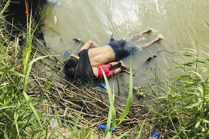 EDS NOTE: GRAPHIC CONTENT - The bodies of Salvadoran migrant Oscar Alberto MartÌnez RamÌrez and his nearly 2-year-old daughter Valeria lie on the bank of the Rio Grande in Matamoros, Mexico, Monday, June 24, 2019, after they drowned trying to cross the river to Brownsville, Texas. Martinez' wife, Tania told Mexican authorities she watched her husband and child disappear in the strong current. (AP Photo/Julia Le Duc)