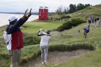 Team Europe's Tyrrell Hatton hits from a bunker on the fourth hole during a practice day at the Ryder Cup at the Whistling Straits Golf Course Wednesday, Sept. 22, 2021, in Sheboygan, Wis. (AP Photo/Ashley Landis)