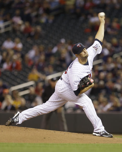 Minnesota Twins pitcher Scott Diamond throws against the Detroit Tigers in the first inning of a baseball game, Tuesday, Sept. 24, 2013, in Minneapolis. (AP Photo/Jim Mone)