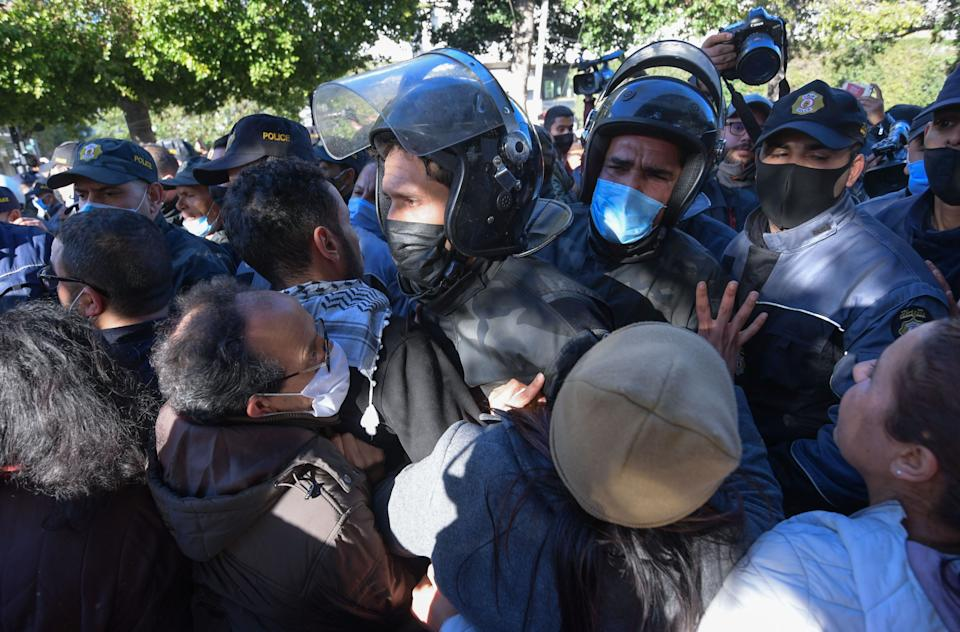 <p>Security forces clash with protesters in Tunis</p> (AFP via Getty Images)