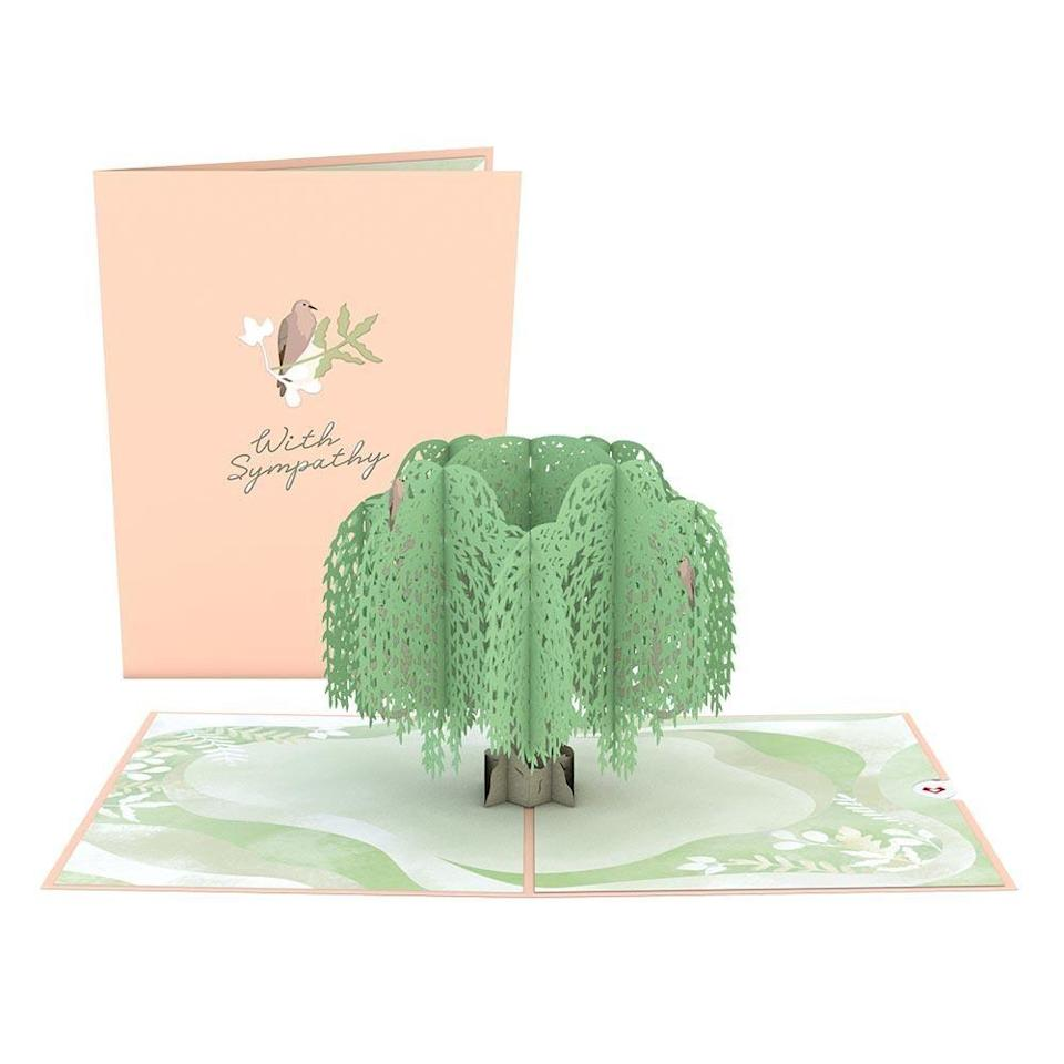 """<p><strong>Lovepop</strong></p><p>lovepopcards.com</p><p><strong>$13.00</strong></p><p><a href=""""https://go.redirectingat.com?id=74968X1596630&url=https%3A%2F%2Fwww.lovepopcards.com%2Fproducts%2Fsympathy-tree-pop-up-card&sref=https%3A%2F%2Fwww.bestproducts.com%2Flifestyle%2Fg35618445%2Fsympathy-gift-ideas%2F"""" rel=""""nofollow noopener"""" target=""""_blank"""" data-ylk=""""slk:Shop Now"""" class=""""link rapid-noclick-resp"""">Shop Now</a></p><p>Sometimes, a handwritten letter or card is simply the perfect sympathy gift. Lovepop's cards truly take it to the next level. </p><p>This sympathy card folds open flat to reveal a pop-up willow tree with a dove perched on it. This poignant imagery is meant to symbolize both sorrow and hope for a new beginning. Besides the words on the front of the card, the interior is blank, so you can add your own personal sentiments.</p>"""