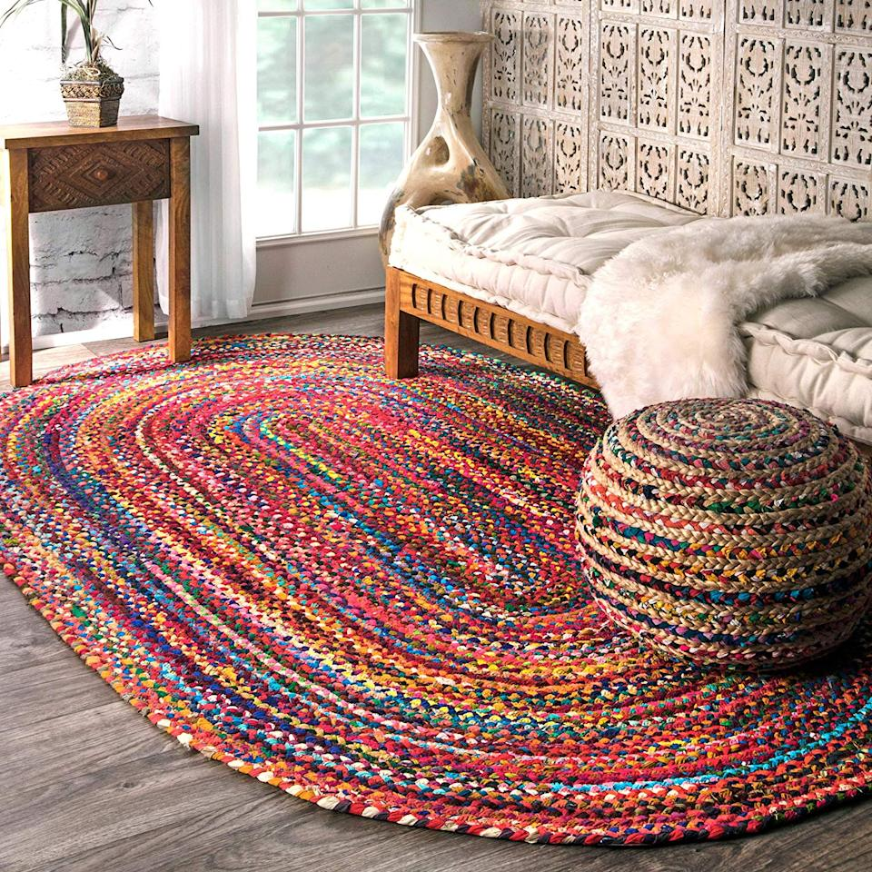 """<a href=""""https://www.amazon.com/dp/B01HDWDWCA"""" rel=""""nofollow noopener"""" target=""""_blank"""" data-ylk=""""slk:NuLOOM Tammara Oval Rug"""" class=""""link rapid-noclick-resp""""><h3>NuLOOM Tammara Oval Rug</h3></a><br>There's something special about a hand-woven design, and this sturdy braided option can withstand footsteps in even the most highly trafficked area of your home.<br><br><strong>nuLOOM</strong> Hand Braided Tammara Cotton Oval Rug, $, available at <a href=""""https://www.amazon.com/nuLOOM-Braided-Bohemian-Colorful-Cotton/dp/B01HDWDWCA"""" rel=""""nofollow noopener"""" target=""""_blank"""" data-ylk=""""slk:Amazon"""" class=""""link rapid-noclick-resp"""">Amazon</a>"""