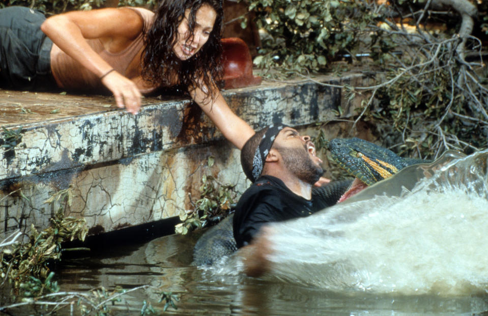 Jennifer Lopez reaching for Ice Cube as he's attacked in scene from the film 'Anaconda', 1997. (Photo by Columbia Pictures/Getty Images)
