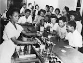 <p>A crowd of teenagers pack the counter at this busy New York City ice cream parlor.</p>