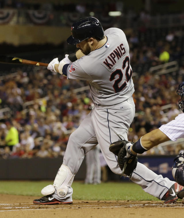 Cleveland Indians' Jason Kipnis hits an RBI-triple off Minnesota Twins pitcher Pedro Hernandez in the first inning of a baseball game on Friday, Sept. 27, 2013, in Minneapolis. (AP Photo/Jim Mone)