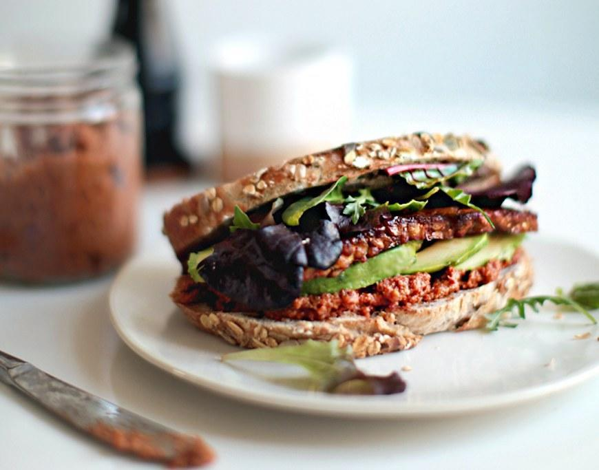 """<p>Tempeh is like tofu's more sophisticated, more deeply textured cousin. Which is to say that this sandwich is very, very much worth trying, whether you're a tofu fan or not. Get the recipe <a href=""""http://www.mynewroots.org/site/2013/04/smoky-tempeh-sandwich-with-sundried-tomato-pesto?mbid=synd_yahoofood"""" rel=""""nofollow noopener"""" target=""""_blank"""" data-ylk=""""slk:here"""" class=""""link rapid-noclick-resp"""">here</a>.</p><p><b>Per one serving (including 2 ounces of smoky tofu and 1/4 avocado):</b> <em>461 calories, 20 grams protein</em></p>"""