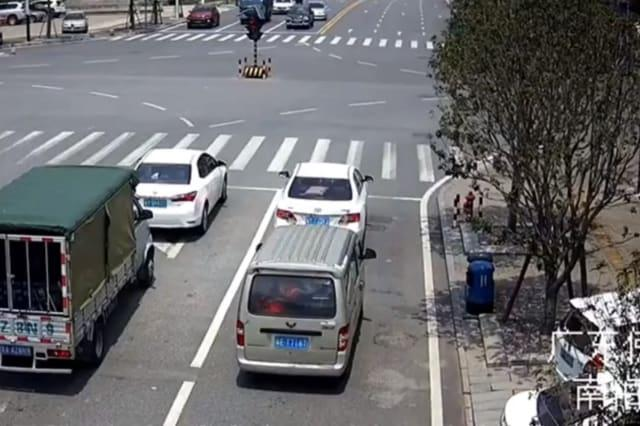 Minibus explodes while waiting at traffic lights in southern China