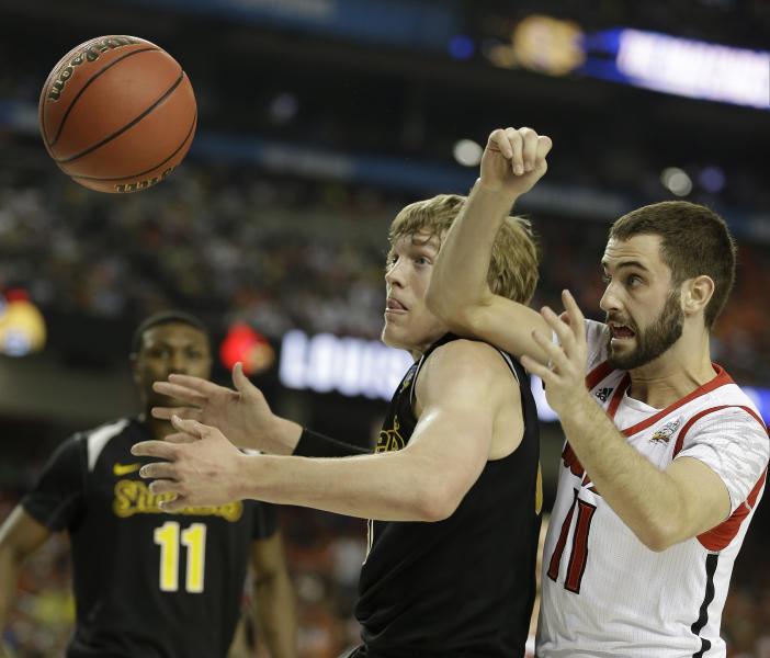 Louisville's Luke Hancock vies for a loose ball against Wichita State's Ron Baker (31) during the first half of the NCAA Final Four tournament college basketball semifinal game Saturday, April 6, 2013, in Atlanta. (AP Photo/Charlie Neibergall)