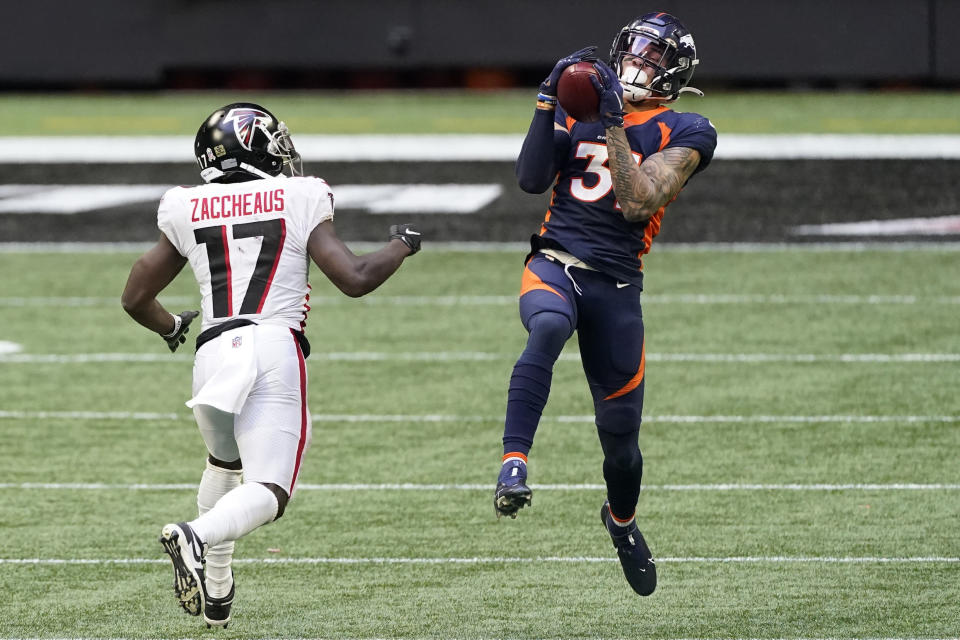 Denver Broncos free safety Justin Simmons (31) intercepts the ball behind Atlanta Falcons wide receiver Olamide Zaccheaus (17) during the second half of an NFL football game, Sunday, Nov. 8, 2020, in Atlanta. (AP Photo/John Bazemore)