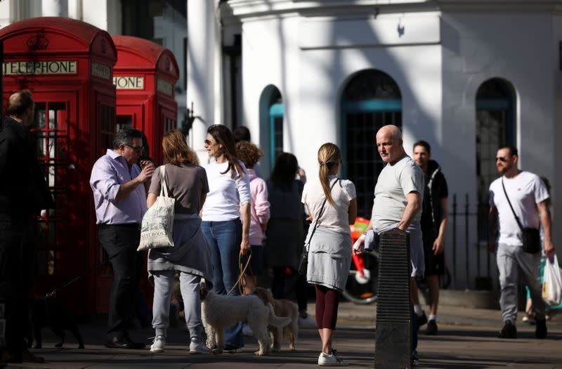 People talk to each other in the street in Primrose Hill, following the easing of lockdown restrictions, amid the spread of the coronavirus disease (COVID-19) outbreak, in London