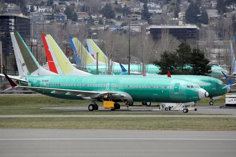 FILE PHOTO: Boeing 737 MAX aircraft are parked at a Boeing production facility in Renton