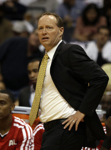 Atlanta Hawks head coach Mike Budenholzer watches from the sideline in the first half of an NBA basketball game against the Toronto Raptors, Friday, Nov. 1, 2013, in Atlanta. (AP Photo/John Bazemore)