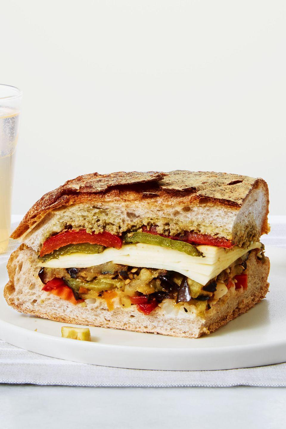 "<p>No matter which way you slice it, this giant New Orleans-style sandwich is stacked with layers of flavor.</p><p><a href=""https://www.goodhousekeeping.com/food-recipes/a39350/grilled-veggie-muffuletta-recipe/"" rel=""nofollow noopener"" target=""_blank"" data-ylk=""slk:Get the recipe for Grilled Veggie Muffuletta »"" class=""link rapid-noclick-resp""><em>Get the recipe for Grilled Veggie Muffuletta »</em></a> </p>"