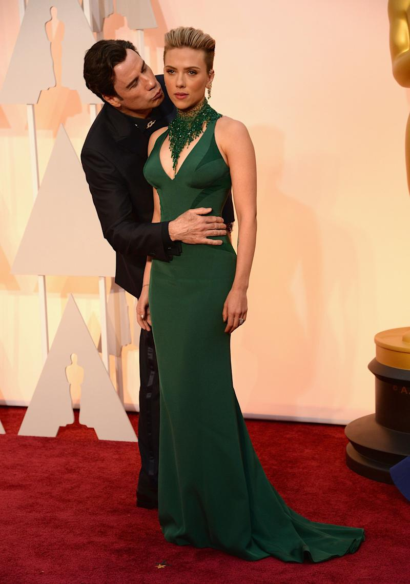 HOLLYWOOD, CA - FEBRUARY 22: Actor John Travolta (L) and actress Scarlett Johansson attend the 87th Annual Academy Awards at Hollywood & Highland Center on February 22, 2015 in Hollywood, California. (Photo by Kevin Mazur/WireImage) (Photo: Kevin Mazur via Getty Images)