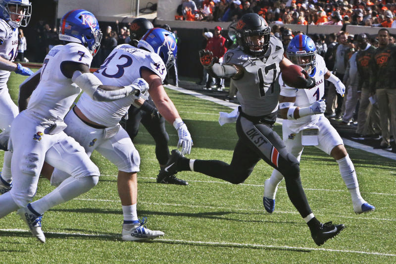 Oklahoma State wide receiver Dillon Stoner (17) carries against Kansas in the first half of an NCAA college football game in Stillwater, Okla., Saturday, Nov. 16, 2019. (AP Photo/Sue Ogrocki)