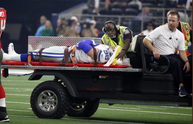 Dallas Cowboys defensive end Tyrone Crawford (98) is carted off the field after suffering an unknown injury in the first half of an NFL football game against the Tampa Bay Buccaneers in Arlington, Texas, Sunday, Dec. 23, 2018. (AP Photo/Michael Ainsworth)