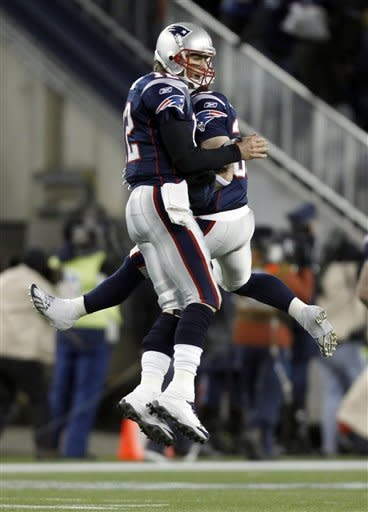 New England Patriots quarterback Tom Brady (12) celebrates with teammate Danny Woodhead after Brady's 61-yard touchdown pass to Deion Branch during the first half of an NFL divisional playoff football game against the Denver Broncos Saturday, Jan. 14, 2012, in Foxborough, Mass. (AP Photo/Charles Krupa)