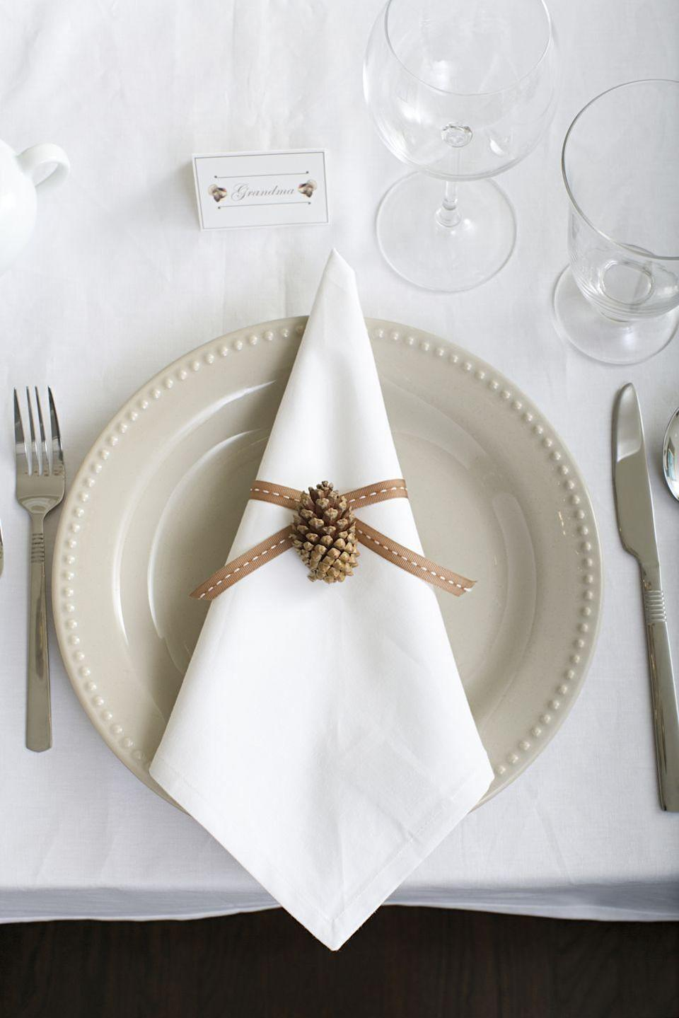 """<p>Thanksgiving is classically a time of bounty, which makes understated decor a breath of fresh air for the Thanksgiving table. A single seasonal touch like a pretty ribbon, leaf, or pine cone can add just the right touch of autumn and lets the rest of your set up take center stage. </p><p><a class=""""link rapid-noclick-resp"""" href=""""https://www.amazon.com/Reliant-Ribbon-25133-055-03K-Grosgrain-Saddle/dp/B07V3SSHX1/ref=sr_1_1?tag=syn-yahoo-20&ascsubtag=%5Bartid%7C10067.g.13616373%5Bsrc%7Cyahoo-us"""" rel=""""nofollow noopener"""" target=""""_blank"""" data-ylk=""""slk:SHOP NOW"""">SHOP NOW</a> <em>Grosgrain Ribbon, $17.33</em></p>"""