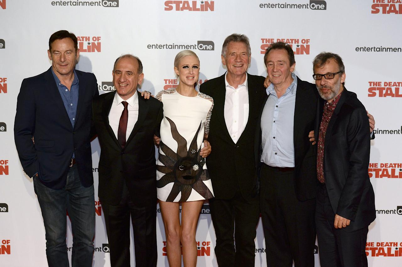 Actor Jason Isaacs, writer and director Armando Iannucci, actors Andrea Riseborough, Michael Palin, Paul Whitehouse and David Schneider  (L-R) arrive for the UK premiere of the film 'The Death of Stalin', in London, Britain, October 17, 2107. REUTERS/Mary Turner