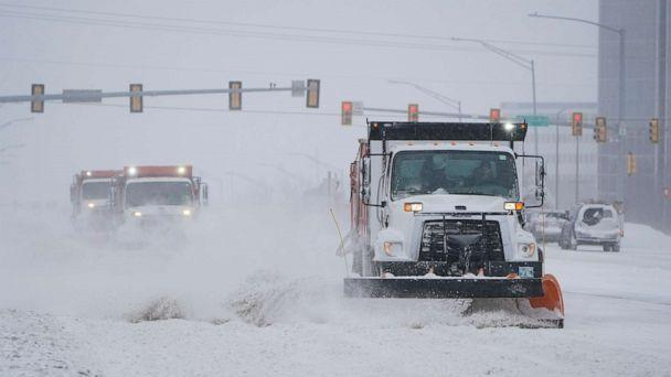 PHOTO: Snowplows works to clear the road during a winter storm Sunday, Feb. 14, 2021, in Oklahoma City. Snow and ice blanketed large swaths of the U.S. on Sunday, prompting canceled flights, making driving perilous and reaching into the Texas Gulf Coast. (Sue Ogrocki/AP)